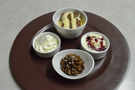 Miniature dessert Buffet Including Milk Chocolate- and White Chocolate Mousse, Cheese Cake and Malva Pudding